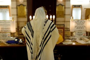 Orthodox Jew honours the memory of a loved one on Yizkor during Yom Kippur, an anniversary of a Jewish funeral